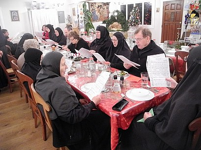 Singing carols at the Lenten 12-Course Dinner on Christmas Eve