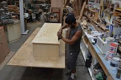 Affixing the casket floor to the casket body